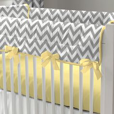 "Gray and Yellow Zig Zag Crib Rail Cover | Carousel Designs.  A perfect solution to help protect your baby's crib while maintaining a stylish decor for your nursery. Our Crib Rail Cover is reversible, enabling you to change the visible side at a moment's notice. Simply wrap the cover around your crib rail, pull the ties though the buttonhole and tie. The crib rail cover measures approximately 50"" long by 18"" wide."