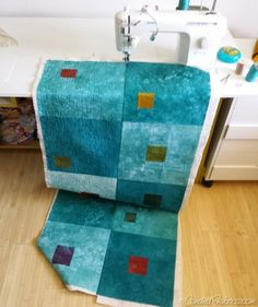 Quilt as you go method - adding one long strip of blocks at a time