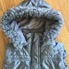 Gray puffer vest . ⛄️⛄️ Cute, warm and gray!  Puffer vest,, detachable hood, side pockets, goes with anything!  ⛄️ New York & Company Jackets & Coats Puffers