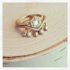Such a unique wedding and engagement ring set! #LoveGold