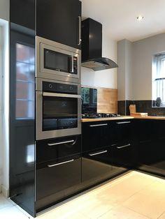 Black high gloss kitchen with slimline pantry.