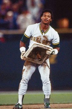 Rickey Henderson played with the Oakland Athletics from He has the most stolen bases in baseball history Famous Baseball Players, Best Baseball Player, Baseball Star, Mlb Players, Baseball Cards, Baseball Wall, Premier League, Baseball Classic, American Sports