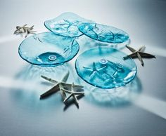 Annieglass handmade sea-themed plates and platters.