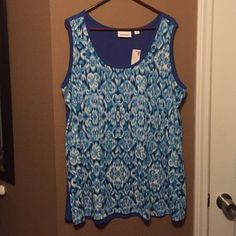 Blue pretty Tank Top! Sleeveless blue tank top with white and blue design on the front and aloud blue on back! Tag says its 22/24 size! Avenue Tops Tank Tops
