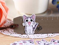 Inspired by popular Japanese manga series, these cute paper stickers illustrate antics of a small kitten Chi. Bring fun to your crafting and DIY projects with them.