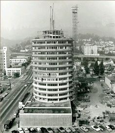Capitol Records under construction in 1955. The wide curved awnings over  windows on each story a8d76a1f6fce