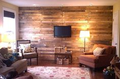 This wall was created using wood from old pallets.  I'm thinking this might look good in the library.