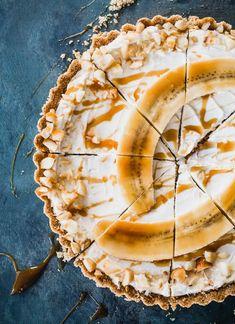 Gluten-free, greek yogurt tart topped with macadamia nuts, caramel, and banana with a @cheerios crust