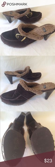 """Stuart Weitzman Faux Fur-lined Brown Suede Clogs Bundle 2 or more items and save! 🎁 Bundle 5 items and I will reimburse the shipping fee 🎉.   Great condition! Fake fur lining inside the clogs. Brown suede clogs. Gold-colored side buckles with """"Stuart Weitzman"""" on them. Studs around the bottom of shoe. Slight nicks on the heels as shown in photos. Slight stain on inside of left clog (along the inside lining) and right clog around the mid-foot. Preloved and in good condition. Stuart Weitzman…"""