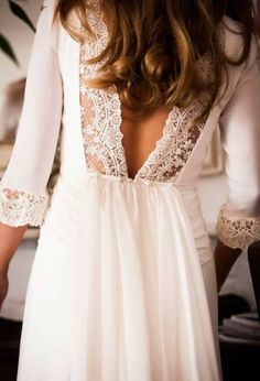 Love the low v back and delicate lace