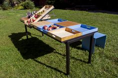 TABLE FOR A CITY / The moving frame panels allow to further transform the table by raising all or some of the pannels up changing the table into a market stand allowing the users to present their products for sale during handicraft or flower market days / fot. szajewski.com