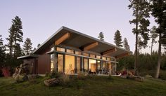 """This unique Stillwater Dwellings prefab home on Bainbridge Island was designed with our signature """"eyebrow"""" window which brings light and space to the main living area. A coordinating smaller prefab ADU sits on the property. Modern Prefab Homes, Prefabricated Houses, Modern Cabins, Modular Homes, Stillwater Dwellings, Small Modern Home, Steel House, Shed Plans, House Plans"""