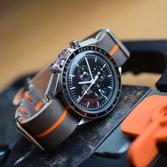 Handmade by Atelier de Griff. Orange striped leather NATO best paired with the Omega Ultraman Speedmaster (Speedytuesday) Elegant Watches, Stylish Watches, Beautiful Watches, Cool Watches, Diesel Watches For Men, Vintage Watches For Men, Omega Moonwatch, Relic Watches, Mens Digital Watches