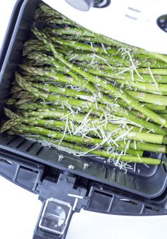 Air Fryer Garlic Parmesan Asparagus is made with garlic, Parmesan cheese, lemon juice, olive oil, salt and ground pepper in a short 10 minutes in the air fryer for an easy side dish you can do with any entree. Parmesan Asparagus, Asparagus Fries, Asparagus Recipe, Garlic Parmesan, Parmesan Recipes, Asparagus Ideas, Garlic Butter, Air Fryer Oven Recipes, Air Fry Recipes