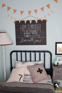 Jenny Lind color combo, Navy blue bed with grey walls. I like how the lamp edge ties with the bed frame