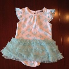 Found while shopping at TotSpot iPhone app : Vitamin Kids Blue Onesie w/Tutu. Download TotSpot from the app store. Shop and sell kids fashion easily.