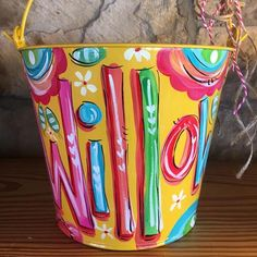Painted Daisies on a yellow metal bucket! Stuff with any of your favorites...Makes for a perfect gift for Easter, Valentine's day, birthday, shower, sprinkle, art supplies (my personal favorite use),
