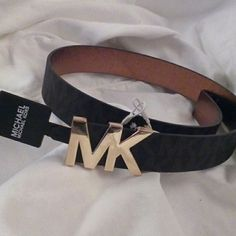 """Michael Kors belt S NWT This Michael Kors belt is a size small. It measures 37"""" from tip to tip. The belt end tucks in behind the buckle. It is dark brown with lighter brown signature M's. This is new with tags.    Open to offers, no trades. Thanks! :) Michael Kors Accessories Belts"""