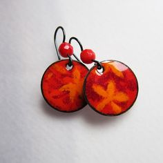 Red orange drop earrings in enamel by OxArtJewelry. Flower stenciled - hand-cut stencil.