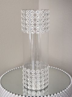 This is a very elegant vase that will give you that luxurious feel in todays modern weddings. The rhinestone ribbon around the vase will capture and enhance any lighting in the room and stand out with a glamorous look. Wedding Vase Centerpieces, Bling Wedding, Wedding Centerpieces, Wedding Table, Wedding Decorations, Centerpiece Flowers, Centerpiece Ideas, Trendy Wedding, Homemade Centerpieces