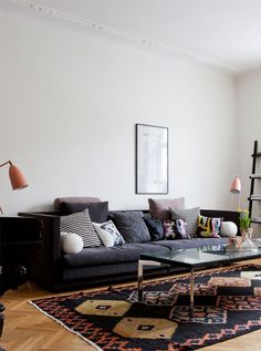 Dark couch, light walls, wood floors—and really like the rug. really really.