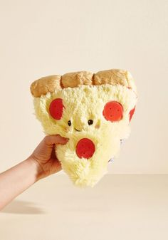 Little Plush One in Pizza -- Get cozy with this cuddly pizza pillow for a charming day of reading and relaxing! Whether you favor fanciful figures or want a savory accent for your room, this quirky little companion offers unconditional adorableness every time you walk through the door.