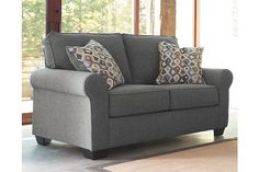 Blending a relaxed sensibility with a richly tailored profile, Nalini loveseat works a modern classic look that's incredibly versatile. Subtly rolled arms give the clean lines a touch of flirt and sense of flow. Plush upholstery, with a textured twill weave and soothing, dusty hue, is easy like a Sunday morning.