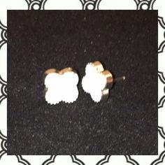 White Clover Stud Earrings New. White enamel with silver tone trim. So cute & so stylish. Classic design for any occasion. No Trades. Price firm unless bundled. All sales final. Ask questions prior to purchasing. I want happy customers! Thanks for visiting & Happy Poshing! Boutique Jewelry Earrings