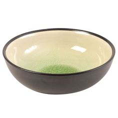 Subtle shadings of green overlay the lace-like crackle glaze of this bowl. To make this piece, gifted artisans from Vietnam form clay in a mold, hand-finish it and apply a crackle glaze to create a piece combining contemporary style with old-world technique. Dishwasher and microwave safe.