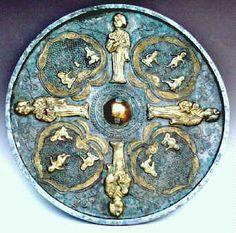 Bronze mirror gold ware with woman boy design, Tang Dynasty (618-906 AD), diameter 24cm. 唐代 鎏金婦女孩童鏡 徑24公分.