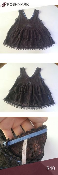 """Free people tank top lace ruffle brown sleeveless This is a lovely tank by Free People. It has no sleeves, gorgeous ruffles, and is made of a heavy lace/crochet. Lovely brown for a neutral piece. The front is a beautiful scoop neck and the back is a low cut v and key hole. Size S. 70% polyester, 30% polyester. Machine wash, dry flat.  Arm pit to arm pit: 17""""-22"""" Waist: 18""""-21"""" Arm pit to hem: 14.5"""" Free People Tops Blouses"""