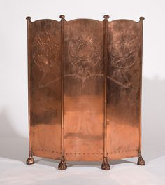 Lot 143 ENGLISH AESTHETIC MOVEMENT COPPER FIRE SCREEN, CIRCA 1895  The three fold adjustable screen incised with foliate art nouveau decoration raised on stylized paw feet. 36 x 29 1/2 in.  Collection of John Alexander, Ltd.  Estimate $ 400-600 Sold for $1,500