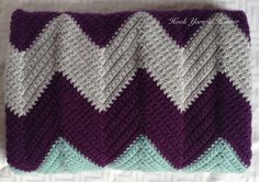 Crochet Baby Blanket by HookYarnAndHooper $64.99  This purple and gray chevron baby blanket has a splash of teal to create a modern preppy look for the new baby girl or boy in your life. It was crocheted in a smoke-free home and measures 31 by 26 inches.   #craftshout0415