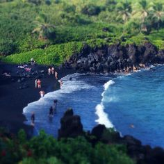 Maui, Hawaii >> All the way down the Road to Hana is a black sand beach at Wainapanapa State Park. Great spot to get out of the car and go for a walk.