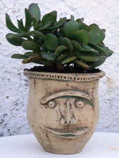 Yes to pots with faces on them.