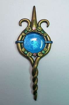 Polymer clay suncatcher with swarvoski crystals and blue glass gem gold green blue | Flickr - Photo Sharing!