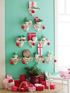 Shelf display Christmas tree on aqua blue wall with pops of red and pretty styling...