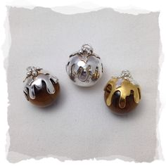 A range of little silver and tigers eye puddings, some with gold plated custard. Mixed Metal Jewelry, Silver Jewelry, Easter Story For Kids, Easter History, Easter Songs, Mistletoe And Wine, Xmas Baubles, Easter Wishes, Christmas Pudding