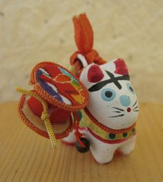 "Little inu hariko talisman with rattle drum on back. 1 1/4""."