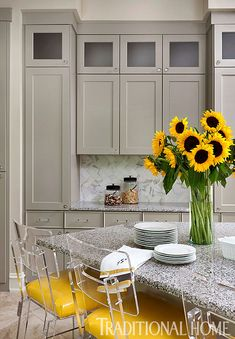 Arkansas Home with a Stylish Palette | Traditional Home yellow lucite counter stools kitchen