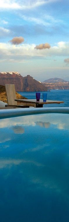 Puffy cloud reflections on the water of the swimming pool beside the sea in Santorini, Greece- ♔LadyLuxury♔ Places Around The World, Oh The Places You'll Go, Travel Around The World, Places To Travel, Places To Visit, Dream Vacations, Vacation Spots, Vacation Destinations, Beautiful World