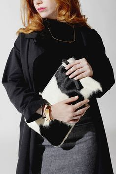 Black + White Cowhide Clutch on www.mooreaseal.com Snag one this weekend during the black friday SALE!