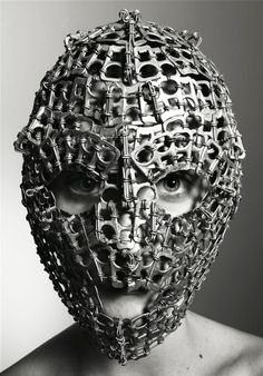 Faces, upon faces... look closely, this creepy thing is made with pop tabs off cola cans.