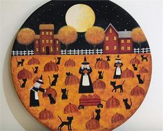 THIS ITEM IS READY TO SHIP  The hand painted original design on this wooden plate features my original Halloween folk art design. Three witches and all their black cats are picking pumpkins in the light of a very full moon. A couple of saltbox houses can be seen on the horizon.  The plate is signed and sealed with matte finish. It measures 11 1/2 inches in diameter and the back of the plate is black.  This plate is intended for decorative use only, but if its used to serve unwrapped food, I…
