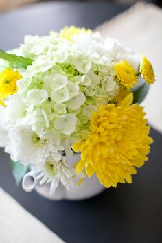Yellow white flowers for wedding table centerpieces