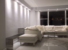 Landskrona Sofa, Modway Gridiron console tables, now in the apt. I still need a large mural and drapery.