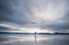 Striking cloudscape with bride and groom. Salt Flats, Utah
