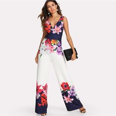 Make a grand entrance in this unique, floral print jumpsuit. Featuring a wide leg, sleeveless silhouette, and v neck front, this jumpsuit looks great paired with heels or wedges for a great sexy-chic look. Casual Jumpsuit, Floral Jumpsuit, Summer Jumpsuit, Printed Jumpsuit, Girl Outfits, Fashion Outfits, Party Fashion, Romper Pants, Fashion Clothes