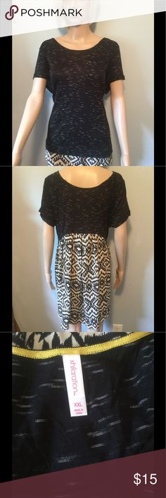 Summer top with cap sleeves. Black-and-white hi/low blouse. Xhilaration Tops Tunics