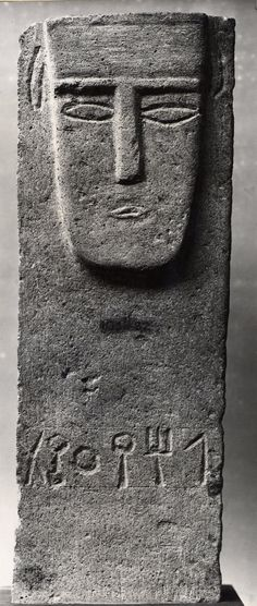 stela; Ancient South Arabian; 2ndC BC; Yemen; Yemen. Limestone stela carved with a male face in relief and a line of inscription with the name Lahay'Athat, possibly in South Arabian.